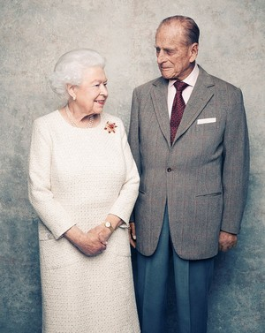 A handout photo shows Britain's Queen Elizabeth and Prince Philip in the White Drawing Room at Windsor Castle in early November, pictured against a platinum-textured backdrop, in celebration of their platinum wedding anniversary on November 20, 2017. (Matt Holyoak/CameraPress/PA Wire/Handout via Reuters)