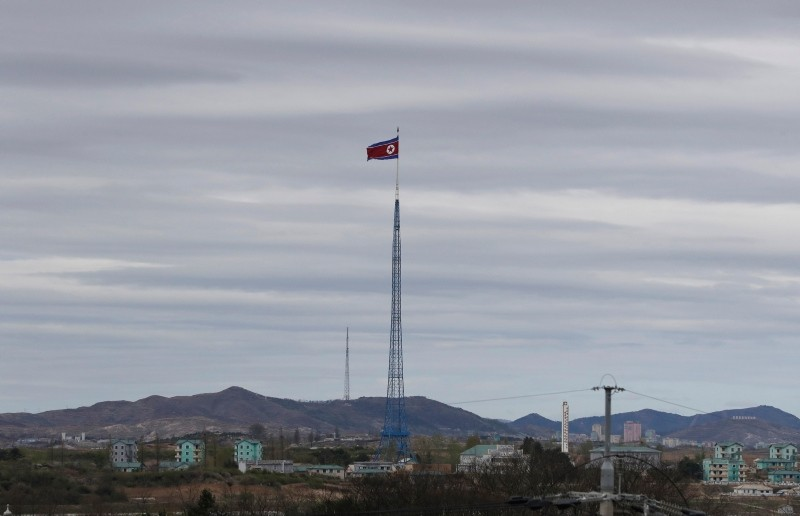 In this April 27, 2018, file photo, a North Korean flag flutters in the wind atop a 160-meter tower in North Korea's village Gijungdongseen, as seen from the Taesungdong freedom village inside the demilitarized zone in Paju, South Korea. (AP Photo)