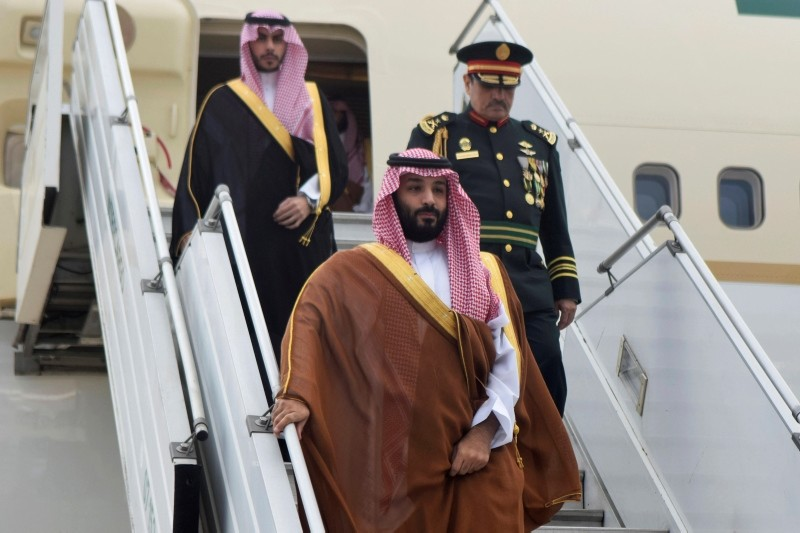 In this photo provided by the G20 Argentina press office, Saudi Arabia's Crown Prince Mohammed bin Salman deplanes at the airport in Buenos Aires, Argentina, Wednesday, Nov. 28, 2018. (G20 Argentina via AP)