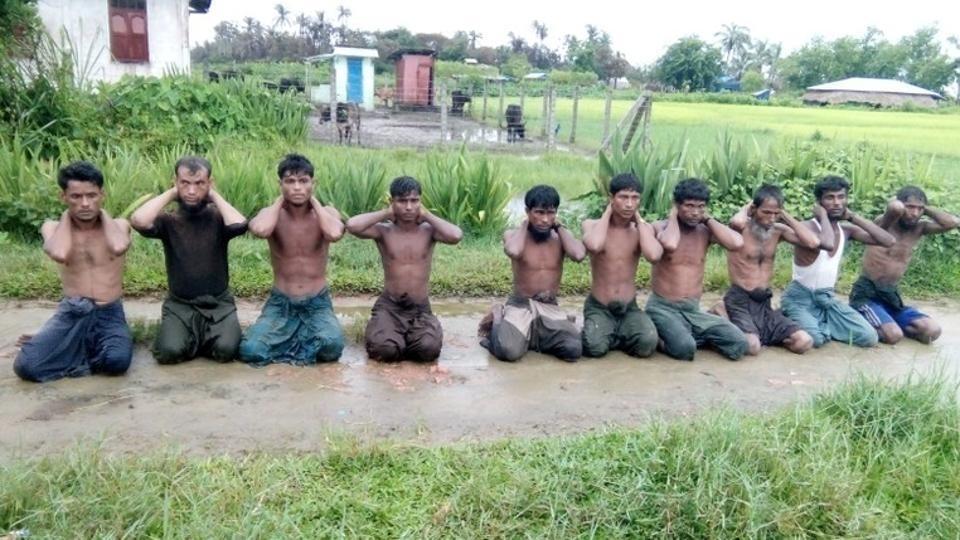 Ten Rohingya Muslim men with their hands bound kneel in Inn Din village September 1, 2017. (REUTERS Photo)