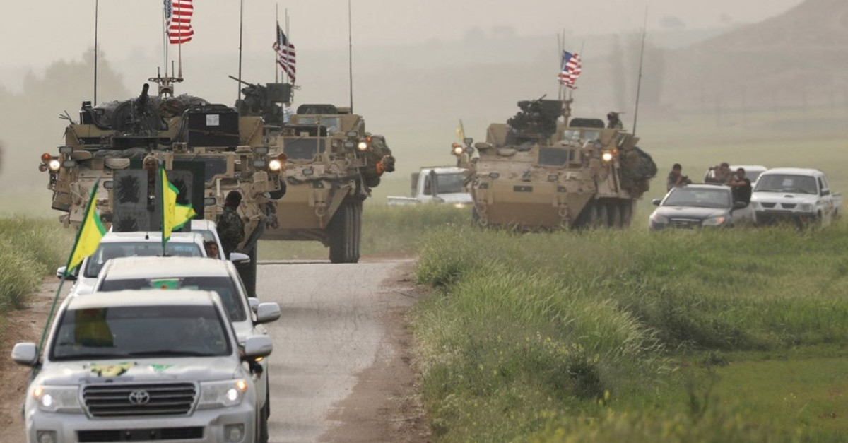 US military convoy follows YPG forces as a sign of years-long cooperation, Dec. 20, 2018.