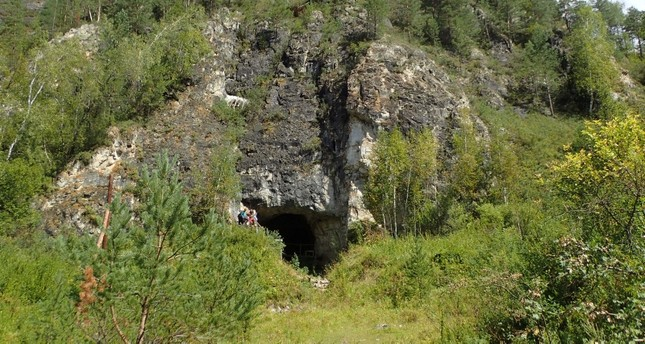 The entrance to Denisova Cave, which contains evidence of previous habitation by extinct human species, in the Anui River valley in the Altai mountains of Siberia, Russia, is shown in this image released on Jan. 30, 2019 (Reuters Photo)