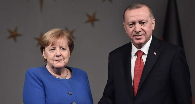 President Recep Tayyip Erdo?an R and German Chancellor Angela Merkel L shake hands after a joint news conference, Istanbul, Jan. 24, 2020. AFP