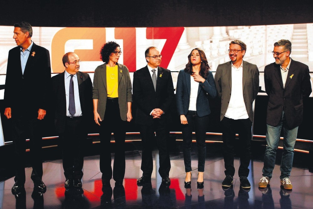 Leaders of Catalonian political parties pose before taking part in a televized debate ahead of the Catalonian regional elections, Barcelona, Dec. 18.