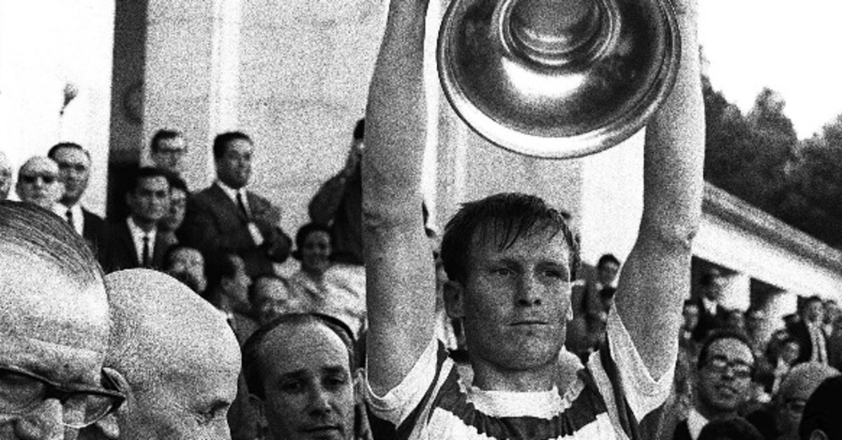 In this May 25, 1967 file photo Celtic soccer team captain Billy McNeill holds aloft the European Cup after it was presented by Portugal's President Americo Tomaz (L) in Lisbon, Portugal.