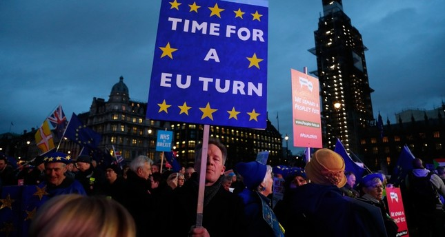 Pro-European demonstrators hold posters at Parliament Square in London, Tuesday, Jan. 15, 2019. (AP Photo)