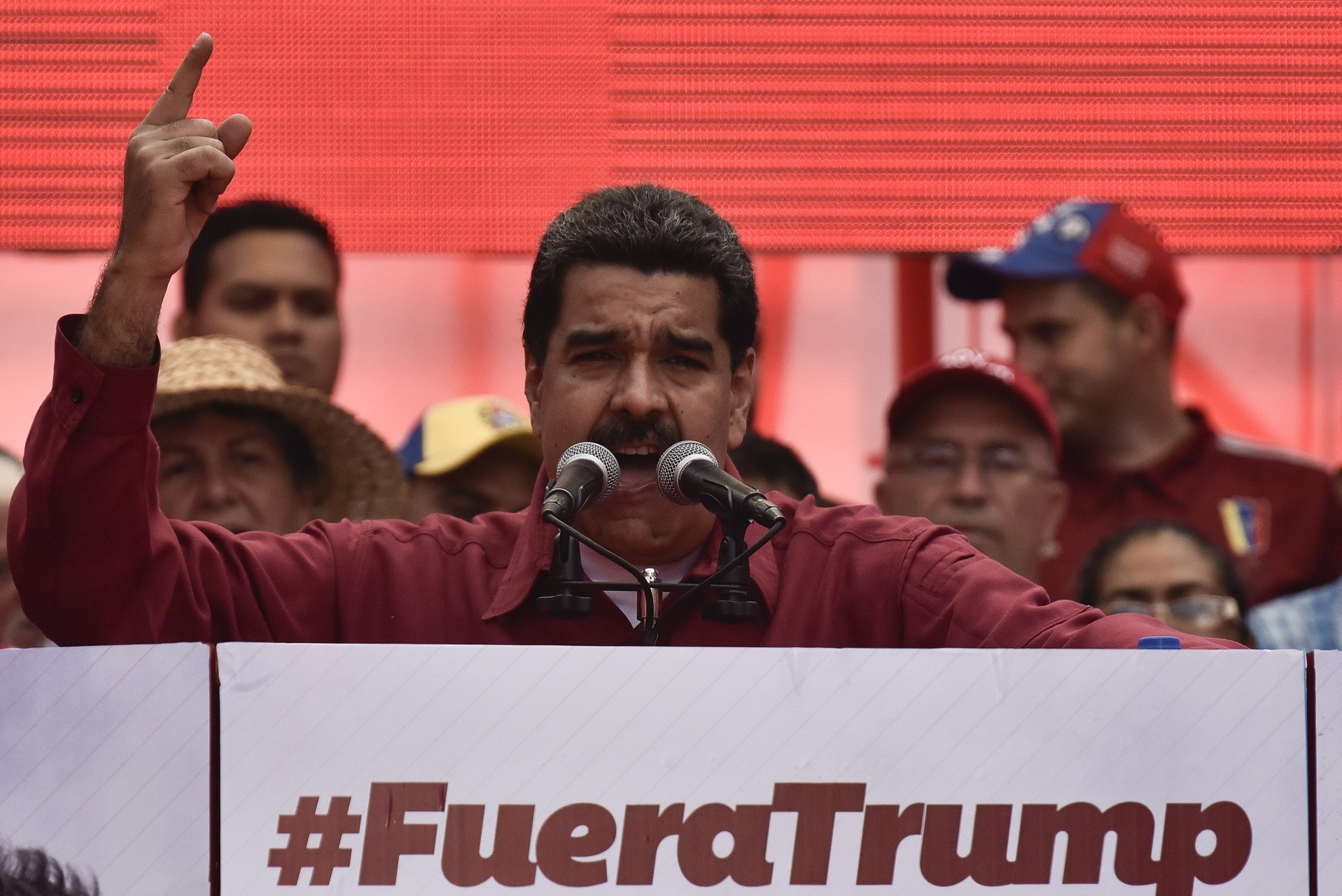 Venezuela's President Nicolas Maduro stands next to a sign that reads ,Trump go away from Latin America, gives a speech at a rally against Trump in Caracas, August 14, 2017. (AA Photo)