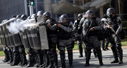pBrazilian soldiers were deployed Wednesday to defend government buildings in the capital Brasilia after protesters demanding the exit of President Michel Temer smashed their way into ministries...