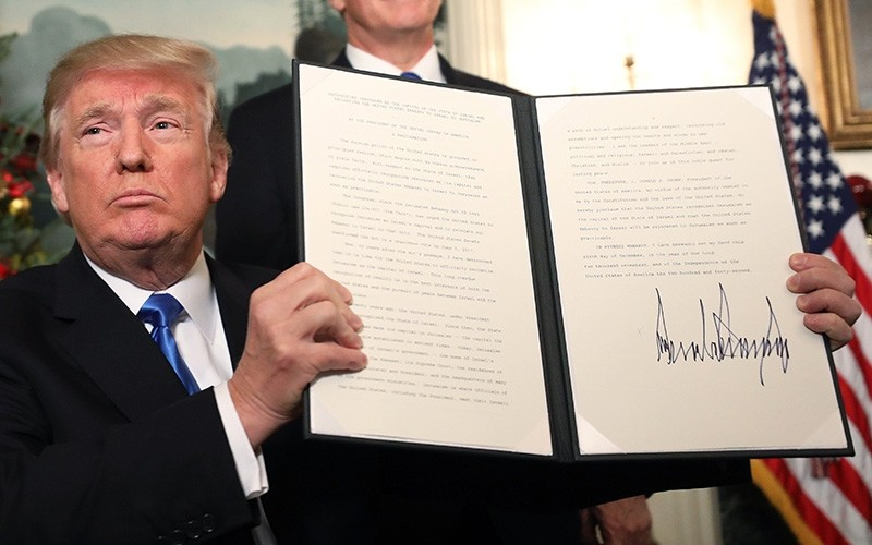 U.S. President Donald Trump signs a proclamantion about his controversial decision to formally recognize Jerusalem as the capital of Israel, and his plan to relocate the U.S. embassy to the city, Washington, D.C., U.S., Dec. 6, 2017. (EPA Photo)