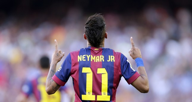 In this May 9, 2015 file photo, FC Barcelona's Neymar celebrates after scoring against Real Sociedad during a Spanish La Liga soccer match at the Camp Nou stadium. (AP Photo)