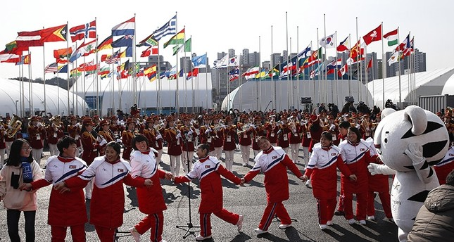 In this Feb. 8, 2018 photo, North Korean athletes dance as members of the county's cheering group perform during a welcome ceremony at the Olympic Village ahead of the 2018 Winter Olympics in Gangneung, South Korea. (AP Photo)