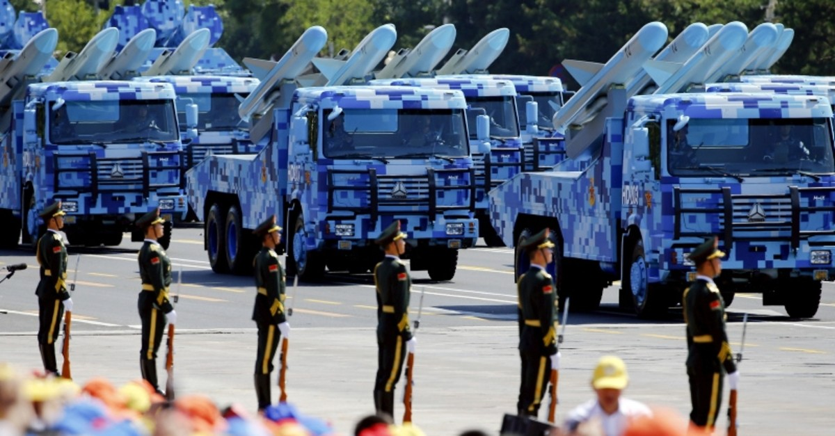 China's People's Liberation Army (PLA) navy soldiers on their vehicles carrying anti-ship missiles roll to Tiananmen Square during the military parade marking the 70th anniversary of the end of WWII, in Beijing, China, Sept. 3, 2015. (Reuters Photo)