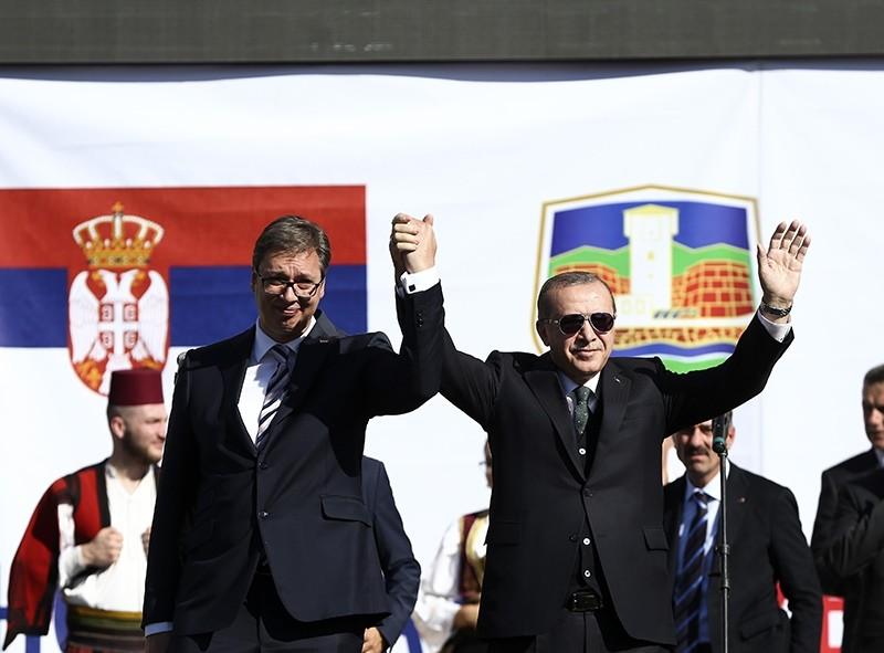 President Recep Tayyip Erdou011fan (R) stands with Serbian counterpart Aleksandar Vucic as they visit predominantly Muslim southwestern region of Novi Pazar, Serbia, Oct. 11, 2017. (AA Photo)