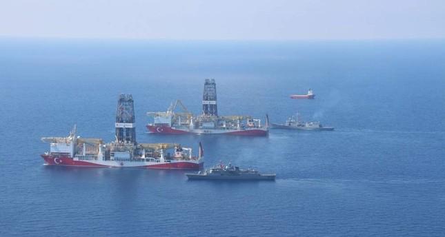 Turkey's drillships Fatih and Yavuz in the Eastern Mediterrenean along with Turkish navy vessels.  IHA File Photo