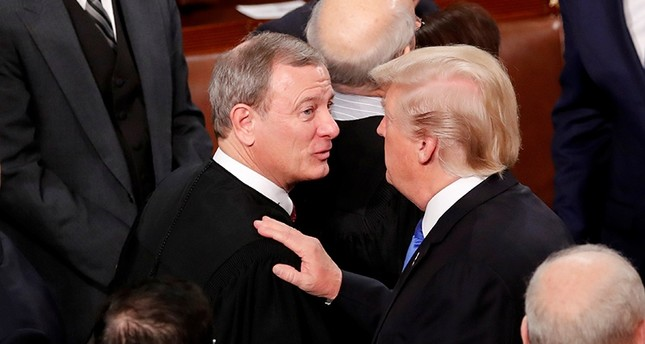 U.S. President Donald Trump (R) talks with U.S. Supreme Court Chief Justice John Roberts as he departs after delivering his State of the Union address to a joint session of the U.S. Congress on Capitol Hill, Jan. 30, 2018. (Reuters Photo)