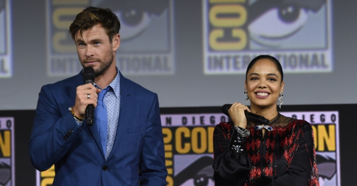 Chris Hemsworth, left, and Tessa Thompson speak during the ,Thor Love And Thunder, portion of the Marvel Studios panel on day three of Comic-Con International on Saturday, July 20, 2019, in San Diego. (AP Photo)