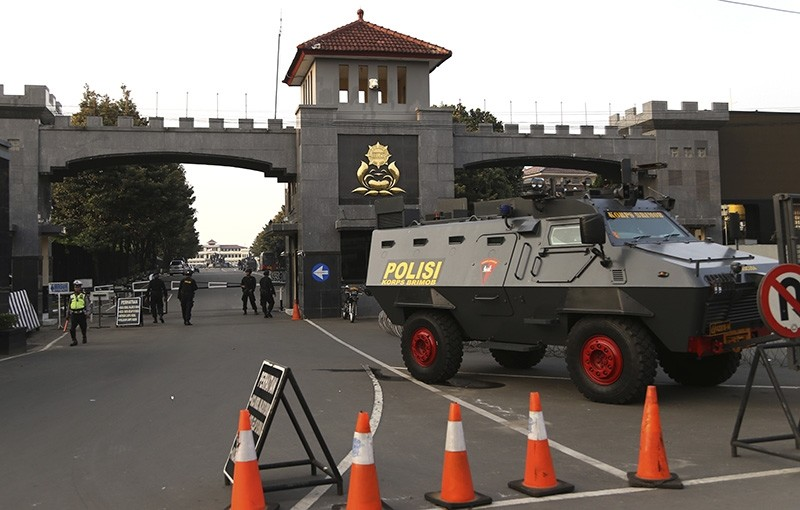 An armored vehicle is parked outside the headquarters of Mobile Brigade, an elite Indonesian police force, following a riot at the detention center inside the compound in Depok, West Java, Indonesia (AP Photo)