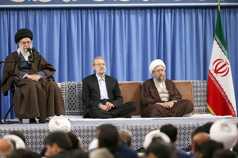 This shows Iranian supreme leader Ayatollah Ali Khamenei (L) delivers speech to the crowds as Parliament Speaker Ali Larijani (C) and Iranian judiciary head Sadegh Larijani listen, during a ceremony in Tehran, Iran, April 14, 2018. (EPA Photo)