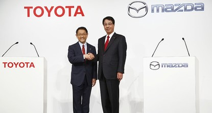 pJapanese automakers Toyota Motor Corp. and Mazda Motor Corp. said Friday they plan to spend $1.6 billion to set up a joint-venture auto manufacturing plant in the U.S. — a move that will...