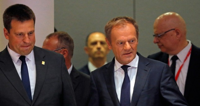 European Council President Donald Tusk, center, and Estonian Prime Minister Juri Ratas, left, arrive for a round table meeting at an EU summit in Brussels, Sunday, June 30, 2019. AP Photo