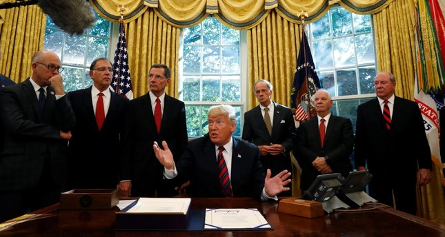 U.S. President Donald Trump talks to reporters about the killing of journalist Jamal Khashoggi in Turkey during a bill signing ceremony at the White House in Washington, Oct. 23.