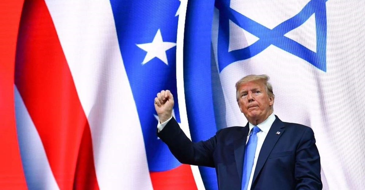 U.S. President Donald Trump stands on stage after his address to the Israeli American Council National Summit 2019, Hollywood, Florida, Dec. 7, 2019. (AFP Photo)
