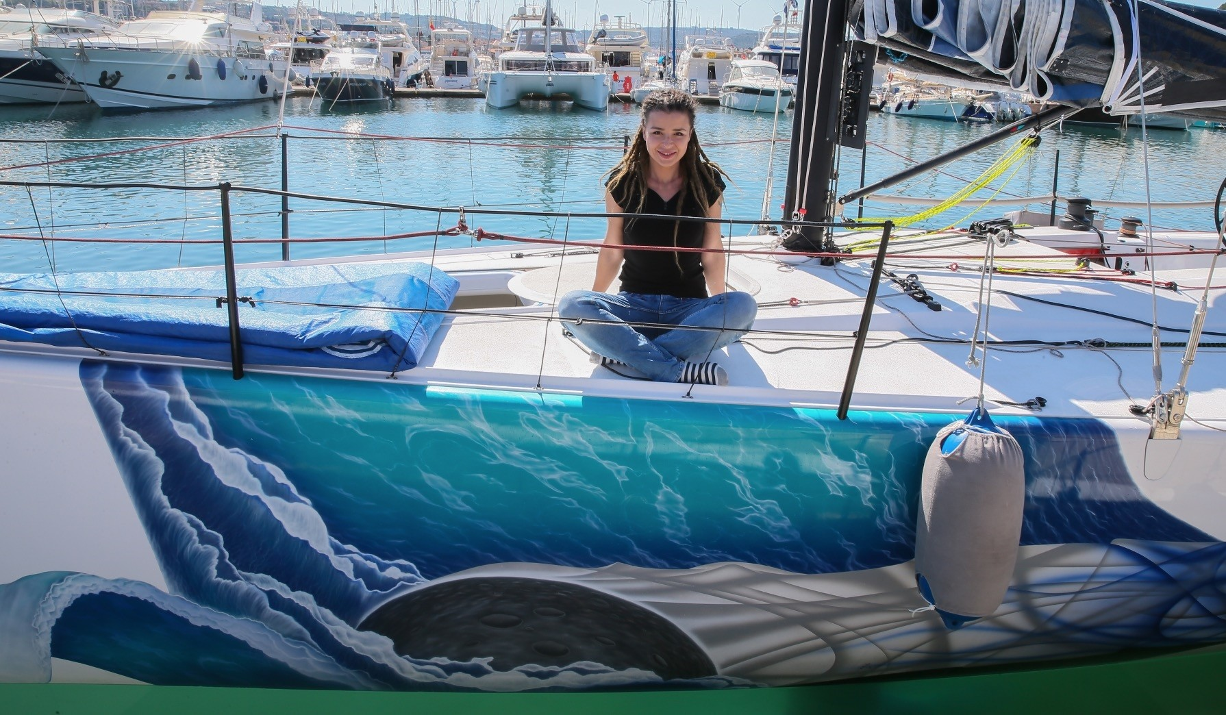Airbrush artist Evrim Duyar poses on a yacht that she decorated.