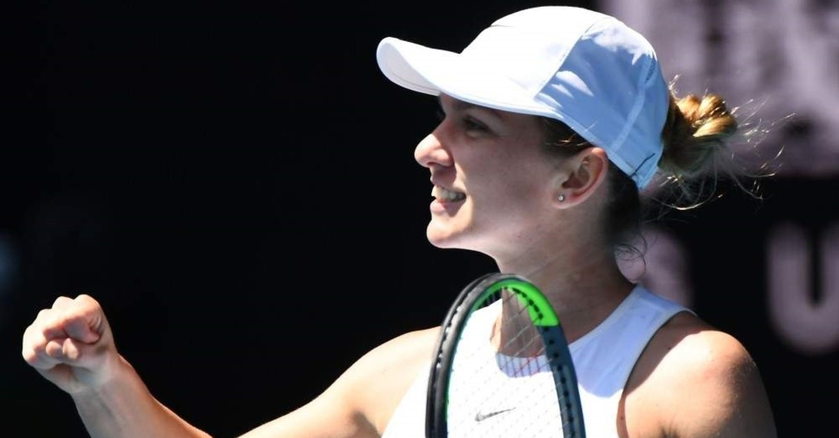 Halep celebrates after beating Kontaveit at the Australian Open quarterfinals in Melbourne, Jan. 29, 2020. (AFP Photo)