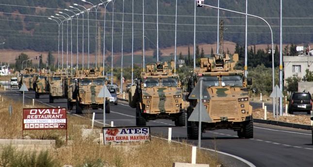 Turkish military vehicles drive to the Syrian border as Operation Peace Spring started hitting PKK-linked terrorist formations in northern Syria, near the southeastern Turkish town of Şanlıurfa, Oct. 9, 2019.