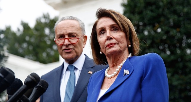 House Speaker Nancy Pelosi of Calif., right, speaks with members of the media alongside Senate Minority Leader Sen. Chuck Schumer of N.Y., after a meeting with President Donald Trump, Wednesday, Oct. 16, 2019, in Washington. (AP Photo)