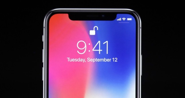 Phil Schiller, Apple's senior vice president of worldwide marketing, announces features of the new iPhone X at the Steve Jobs Theater on the new Apple campus on Tuesday.