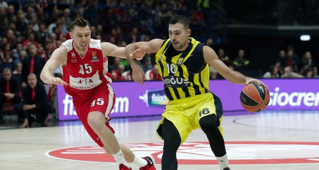 Dairis Bertans (L) and Kostas Sloukas in action during the Euroleague basketball match EA7 Olimpia Milano vs Fenerbahce Doğuş at the Assago Forum.