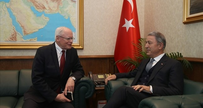 Defense Minister Hulusi Akar (right) speaks with U.S. Special Representative for Syria James Jeffrey (left) in Ankara on Fri. Jan. 25, 2019 (IHA Photo)