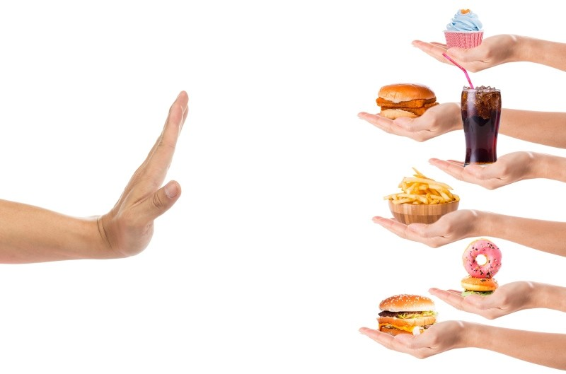 Hand refusing junk food or fast food with white background. (SABAH Photo)