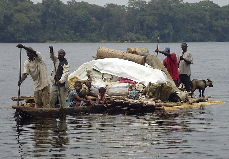 Handout photo dated Aug. 24, 2010 and made available by U.N.-backed Radio Okapi shows Congolese villagers crossing the Ruki river on a small canoe in Balongo, in Equateur, northwestern province of the Democratic Republic of the Congo. (EPA Photo)