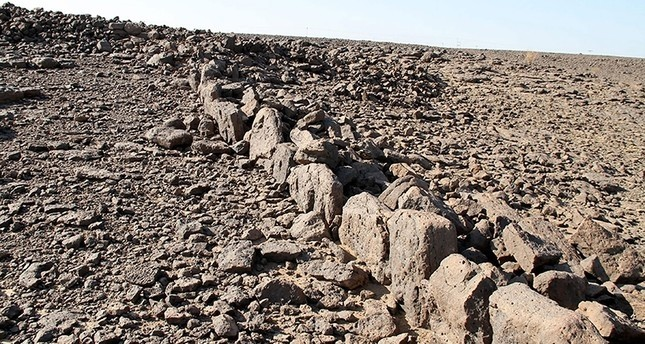 This undated handout picture released by the University of Western Australia shows the mysterious ancient structures built from stone in undisclosed locations across the desert in Saudi Arabia. (AFP Photo)