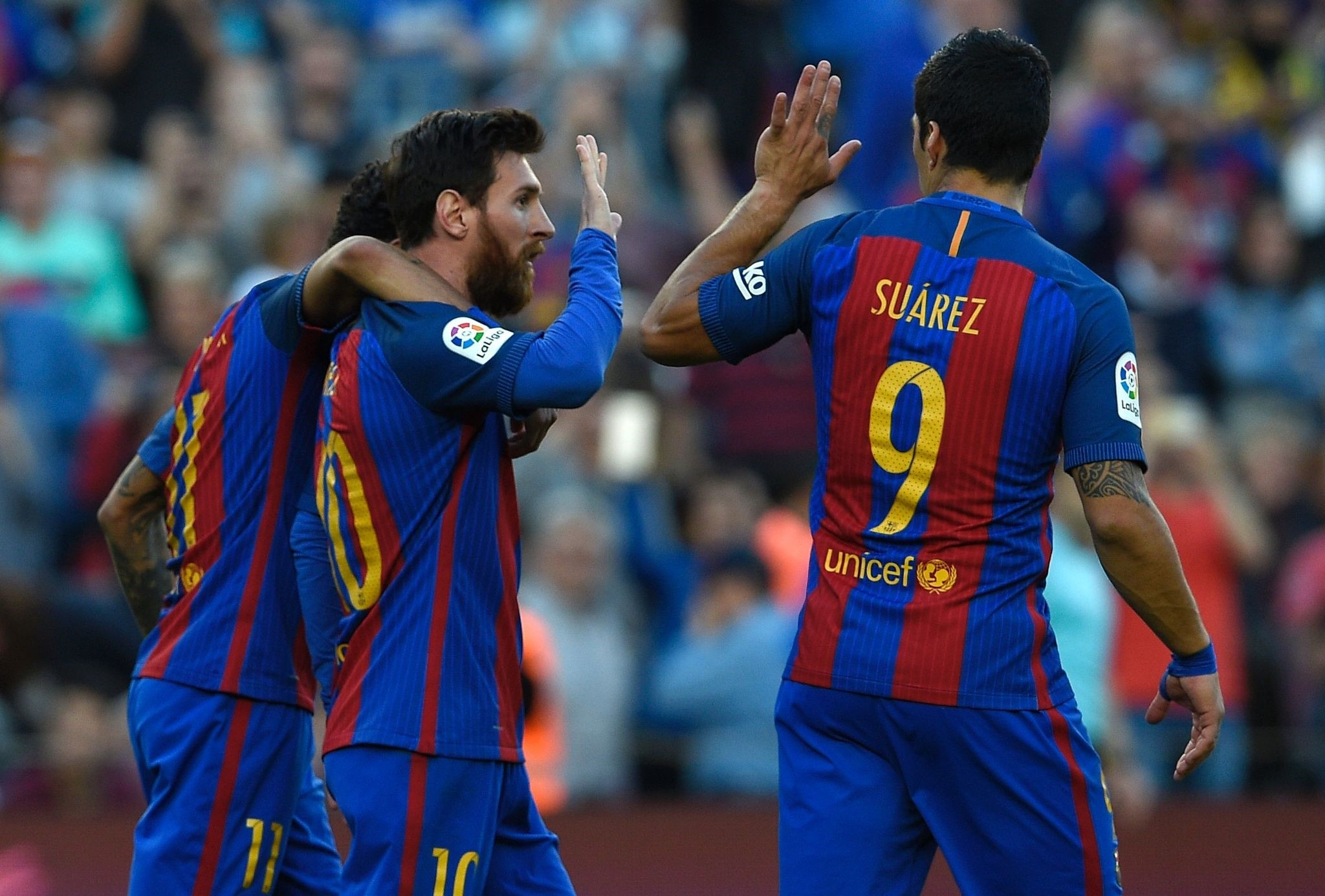 Messi (C) celebrates a goal with Luis Suarez (R) and Neymar during the Spanish league football match FC Barcelona vs Villarreal CF at the Camp Nou stadium.
