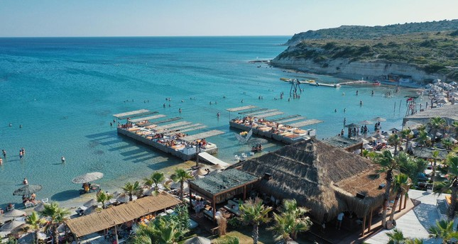 Fly-Inn is a popular beach in Çeşme with its palm trees, golden dust beach and deep blue sea.