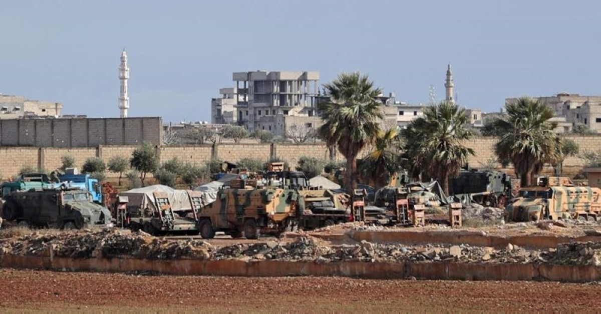 This picture taken on February 7, 2020 shows Turkish military vehicles stationed at a Turkish army observation point near Sarmin on the outskirts of the city of Idlib in the northwestern Syrian Idlib province. (AFP Photo)