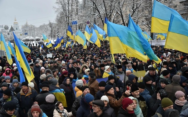 Ukrainians take part in a rally outside of St. Sophia Cathedral ahead of a historic synod expected to establish an Orthodox church independent from Russia, in Kiev, Dec. 15.