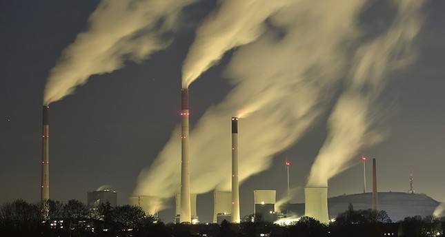 In this Nov. 24, 2014 file photo, smoke streams from the chimneys of the E.ON coal-fired power station in Gelsenkirchen, Germany (AP Photo)
