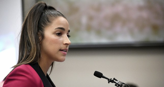 In this Jan. 19, 2018, file photo, Olympic gold medalist Aly Raisman gives her victim impact statement in Lansing, Mich., during the fourth day of sentencing for former sports doctor Larry Nassar. (AP Photo)