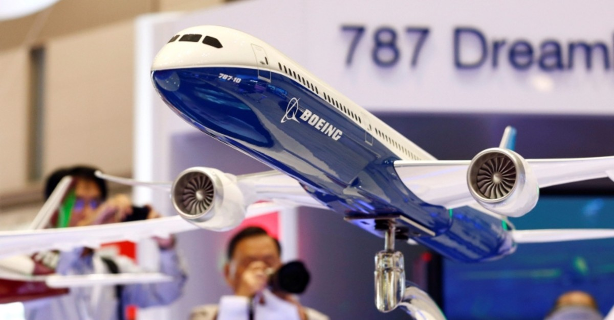 Visitors take pictures of a model of Boeing's 787 Dreamliner during Japan Aerospace 2016 air show in Tokyo, Japan, Oct. 12, 2016. (Reuters Photo)