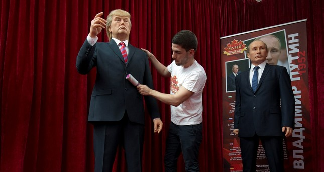 The wax models of US President Donald Trump, left, and Russian President Vladimir Putin, right, are displayed in Sofia, Friday March 31, 2017. (AP Photo)
