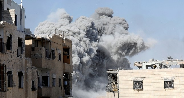 Smoke rises after an air strike by the coalition forces near the stadium in Raqqa, Syria, Oct. 4, 2017 (Reuters Photo)
