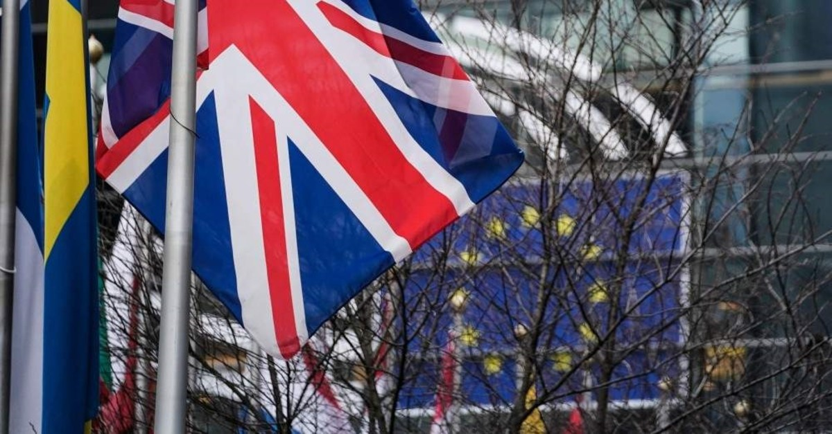 A picture taken on Jan. 23, 2020 shows the European Union flag and the British Union Jack waving in front of the European Parliament in Brussels. (Photo by AFP)