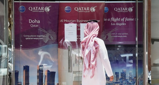 A man standing outside the Qatar Airways branch in the Saudi capital Riyadh after it had suspended all flights to Saudi Arabia following a severing of relations between major Gulf states and Qatar, June 5.