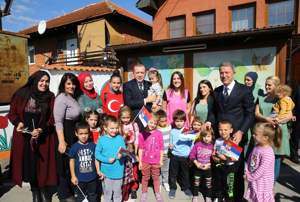 President Erdou011fan (C) accompanied by Chief of Staff Akar (R) pose for a picture during a visit in Novi Pazar, Serbia, Oct. 11.