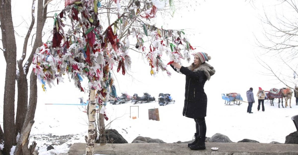 People hang colorful pieces of cloth on the branches of wishing trees to get one step closer to having their wishes come true.
