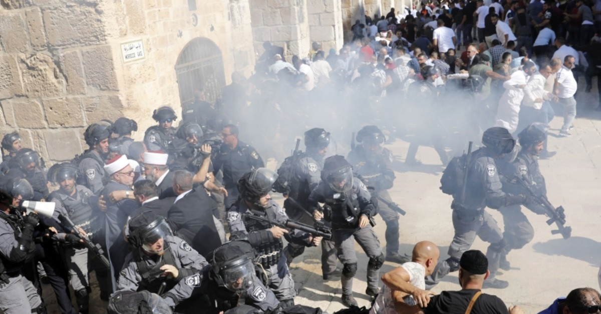 Israeli security forces fire sound grenades inside the Al-Aqsa Mosque compound in the Old City of Jerusalem on August 11, 2019, as clashes broke out. (AFP Photo)